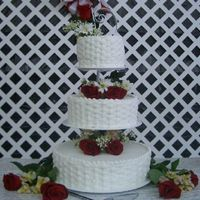 My First Wedding Cake Floating cake stand, basket weave. Lucky for me the bride wanted fresh roses/flowers. The top layer is golden vanilla /bluberry filling,...
