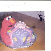 Elmo Present is cake covered in fondant with fondant bow. Elmo is RKT covered in red buttercream pulled out using the multi hole tip (sore hand...