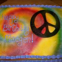 Peace buttercream frosting with airbrushed art.