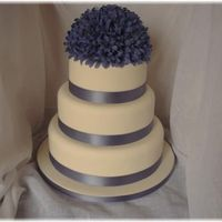 Blue Wedding Cake Ivory Fondant covered cake with silk flowers and matching satin ribbon