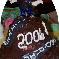"Long Road I made this cake last night fo rmy oldest son who just recieved his GED. It say"" Its been a long road Rickey. I made the figure with..."