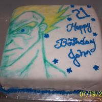 Drogon Ball Z- Gouku 2 layer sponge cake w/ MMF and buttercream accents. My son drew the Gouku pix with edible food writers.