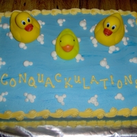 "Rubber Duck Theme I did this cake for a Baby Shower. I wanted to come up with something catchy to say and I came up with ""Conquackulations!"" She..."
