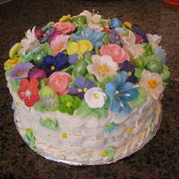 Basketweave Cake This was for my sister's 14th birthday. She loves flower basket cakes. I made the majority of the flowers with royal frosting but...