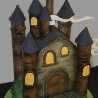 Harry Potter Castle Iced in buttercream with fondant coverd styrofoam for the towers. Wafer paper 'clouds'.