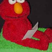 Sitting Elmo This is supported with a wooden dowel attached to the baseboard and another board attached to the top of the dowel to support the cake used...