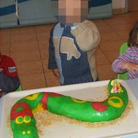 "Happy Green Snake  This is the birthday cake for day care party of my 2 years old son. It's a rolled cake (Italian ""pasta biscotto"") filled..."