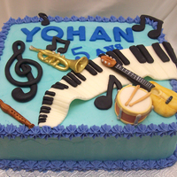 Music Theme Cake This is a chocolate cake with vanilla buttercream and fondant accents. TFL