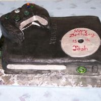 Xbox 360 Cake Did this for my son's birthday. Choc cake, vanilla mousse iced in chocl BC with fondant accents. Controller is a bit fat, was afraid...