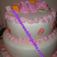 Two Tier Fondant Shower Cake/bootie A fondant covered cake created for an expecting Mother. Baby bootie, building blocks and flowers adorn the top. Cake was dusted with...