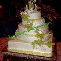 Tracys_Weddingcake0709.jpg My newest wedding cake. This was done on Sat July 25th,09. Fondant with gumpaste flowers. Bottom tier is a fake cake covered with fondant....