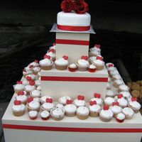 Lisa's Wedding french vanilla cake and cupcakes - cake covered in fondant with silk roses on top - red chocolate hearts on the cupcakes - bride wanted a...