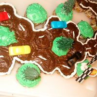 Race Track Cupcakes Cake I made this for my son's school for his birthday. I squished cupcakes together and iced over the top.