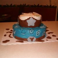Cowboy b/c with choc mm fondant belt, buckle, cow spots, color flow icing print on top