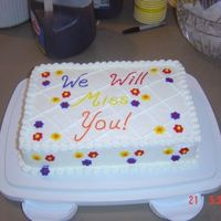 Going Away Party Cake I followed some advice I saw on this web site and made my flowers and words with royal icing. Unfortunately, one of the flowers must have...