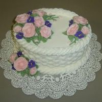 Janaes_Basketweave_Caketake2.jpg This was a chocolate cake with almond flavored buttercream. The violets were royal icing.