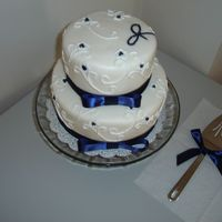 "Two Tier Navy And White Cake  I made this cake for a lady who retired from work. Her first name begins with a ""J,"" hence the ""J"" on the top. Each..."