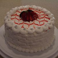 Strawberry Cake I made this for a potluck at my husband's work. It's vanilla cake with whipped cream cheese and fresh sliced strawberry filling,...