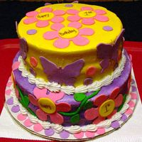 Butterflies, Daisies & Dots Cake This cake was for a little girl's first birthday. The 8 & 10 butter vanilla cake tiers were iced in buttercream then airbrushed....