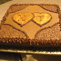 "Golden Hearts This 14"" raspberry chocolate cake was iced in chocolate buttercream with cornelli lace touches and gold painted fondant hearts"