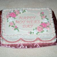 Mothers_Day_2_004.jpg butter pecan cake with maple icing. Everything is buttercream. This was my first time decorating a rectagular shaped cake. Wasn't...