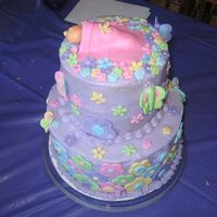 Jules Shower baby shower cake for my little sister, vanilla cake strawberry cream cheese filling. theme was butterflies and flowers..