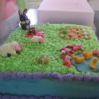 Another Easter Cake Choc cake, cc icing, fondant critters and candy clay rabbit.. cake didn't transport well( sides alittle messed up) but my extended...