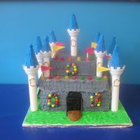 Castle this was a challenge! I originally covered it in fondant, but then the fondant was tearing & I couldn't get it to look right....so...