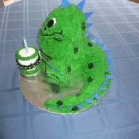 Dinosaur Got the idea from a Wilton cake book. Made for a first birthday, with small cake for smash cake.