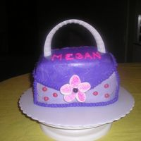 Purse Cake made for a co-worker; covered in bc, adorned with candies, handle is edge of plastic plate, flower is a big marshmallow cut with damp...