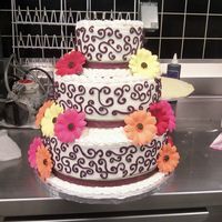 Fall Wedding Cake With Flowers burgundy scroll designs added gumpaste flowers