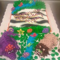 Jungle Baby this is a half sheet cake with two cupcake critters made to look like an alligator and a lion the cake was airbrushed for the zebra effect...