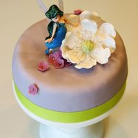 "Silvermist Fairy Mini Cake 6"" round fondant cake with plastic Silvermist fairy figurine, left over sugarpaste magnolia and fondant flower decorations. This was..."