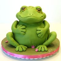Frog Friendly Frog from Debbie Brown's 50 Easy Party Cakes. Made from pound cake covered in fondant for my daughter's 3rd birthday