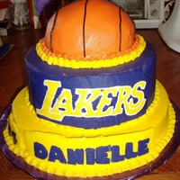 Lakers Basketball Cake Special request from a 10 year old girl wanted her team, number and a basketball on a stacked cake. All buttercream. Logo, name and number...