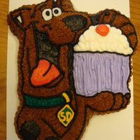 Scooby Doo Cake  I made this cake to go along with the Scooby Doo cupcakes that I made for my BFF's daughter's birthday party. It is chocolate...