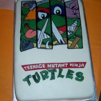 "Teenage Mutant Ninja Turtles Groomscake This grooms cake was modeled after the grooms favorite t-shirt picture. It is mmf base, with gum paste ""turtles"" and lettering,..."