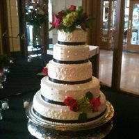Elegant 5-Tier Wedding Cake This is one of my favorites, simple and elegant with the black ribbon and fresh flowers on buttercream.