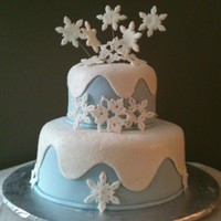 Snowflake Bridal Shower Cake This cake was made for a friend's bridal shower, inspired by one I saw in a Wilton book. The cake inside was a milk chocolate with...