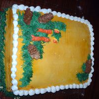 Christmas Cake With Candles And Pinecones I got the Idea from the Roland Winbecker (sp?) book on buttercream flowers. I made it for my piano teacher. She needed it for a party I...