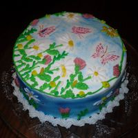 Spring Cake With Butterflies The butterflies were stenciled with wilton pearl dust. I really like the way that turned out. All the flowers were freehanded on the cake....