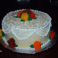 Lacey Fall Cake This is a variation on the wilton cake because I didn't have a loaf pan. All Buttercream. And the first time I've done mums. I&#...