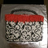 Purse Cake  This is only my 2nd purse cake to do. Sorry you can't see the top very well. It is a french vanilla cake with strawberry filling. All...