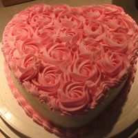 "Valentine's Party Cake This is a 9"" heart (french vanilla) with BC icing and covered in BC rosettes. For a coworker's daughter's daycare party. She..."