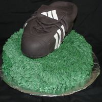 Soccer Cleat Made this for our end of season soccer party. The cleat is chocolate cake with IMBC and covered in fondant.