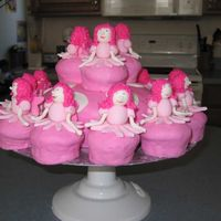 12 Dancing Fairies  The idea was taken from Debbie Brown's Enchanted Cakes book. My daughter was having a fairy party for her 5th birthday so I tweaked...