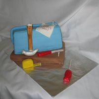 Tool Box Cake   This was made for a construction worker. I used 13x9 cut and stacked cake. Everything was done using MMF.