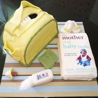 Diaper Bag & Baby Book Hand carved diaper bag, edible image for book and powder logo, fondant washcloth, soother and booties. Inspired by the many diaper bag...