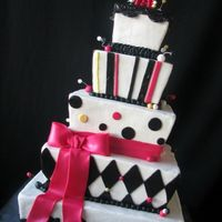 Whimsical Squares A fun bride who wanted formal and fun; BC with fondant accents, gumpaste bow and topper. So fun to do and she was ecstatic about it!