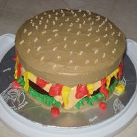 "My First Hamburger Cake I made this for my son's 13th birthday. I kinda messed up with the ""mustard"" and ""ketchup"", but I think it turned..."